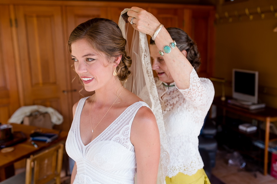 putting on the beautiful lace veil