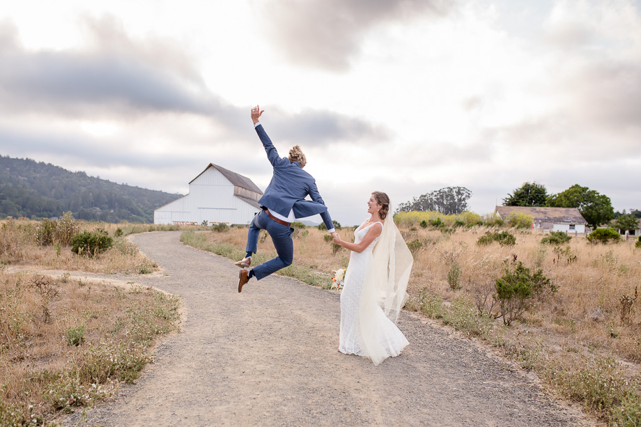 ecstatic groom kicking in the air - San Francisco photojournalistic wedding photographer