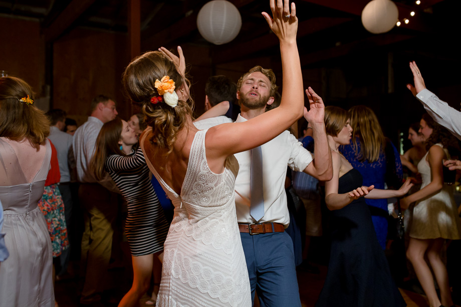 bride and groom having fun at the dance party - Tobys Feed Barn wedding reception