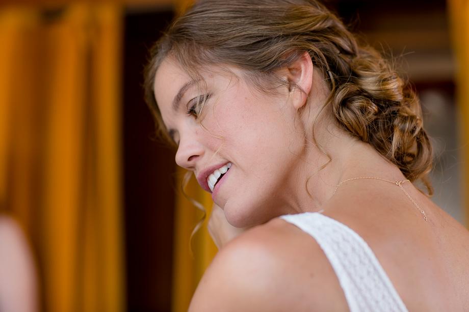 bride putting on her wedding earrings