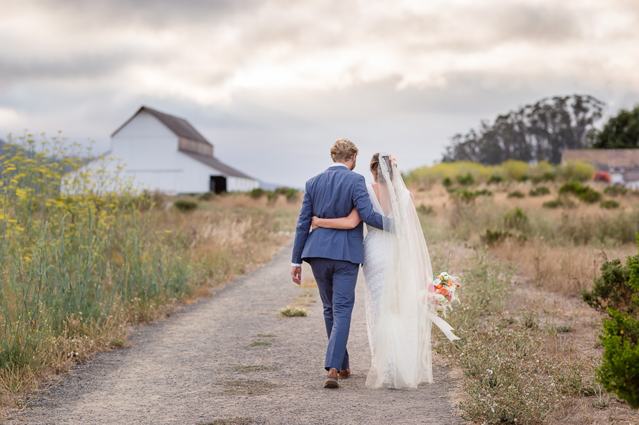 a super romantic candid walking photo of the bride and groom - San Francisco wedding photographer
