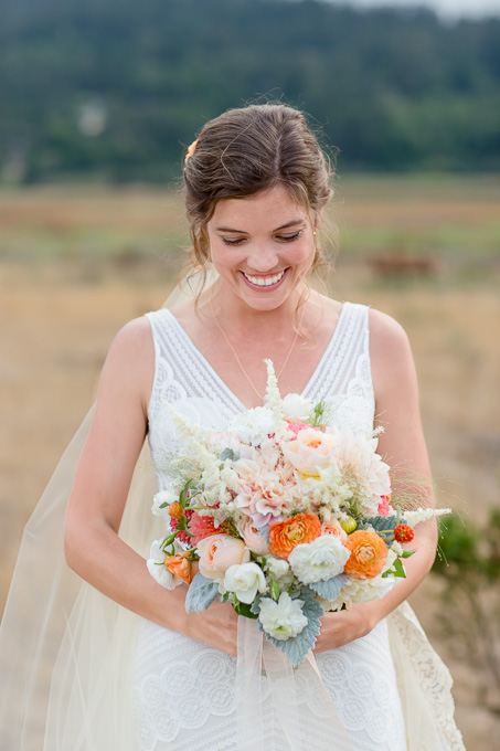 lush bridal bouqet with ivory sheath wedding gown - San Francisco wedding photographer