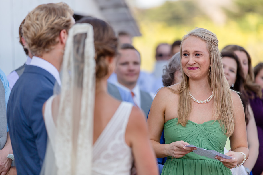 bridesmaid getting emotional when giving a speech during the wedding ceremony