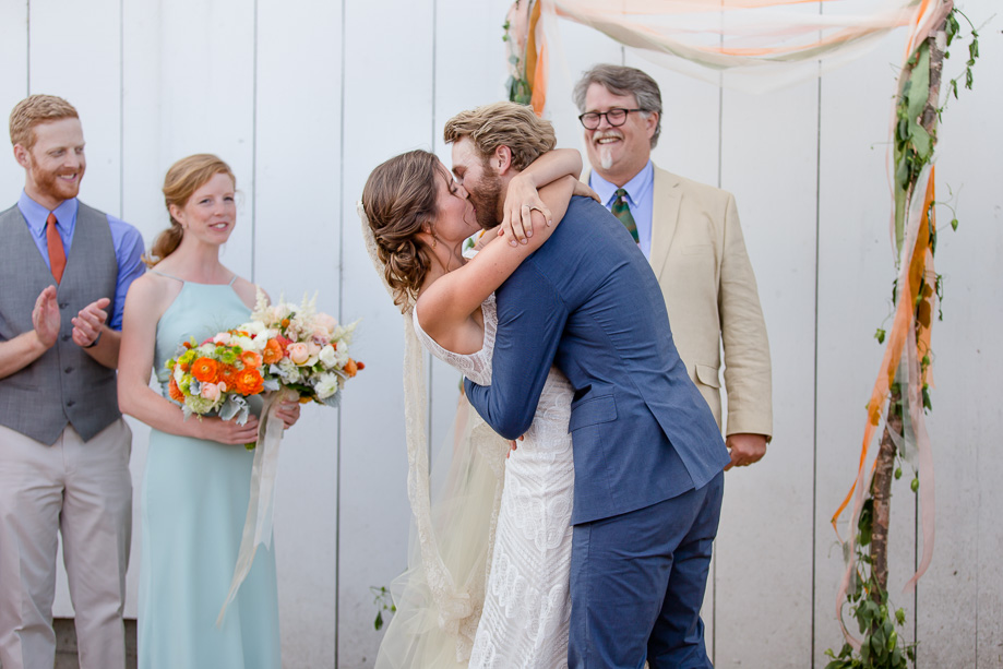 a romantic first kiss as husband and wife - Bay Area lifestyle photographer